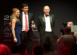 CARDIFF, WALES - Monday, October 5, 2015: Wales' manager Chris Coleman receives his Media Choice award from Kate Suddards and head of pubic affairs Ian Gwyn Hughes during the FAW Awards Dinner at Cardiff City Hall. (Pic by Ian Cook/Propaganda)