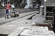 A boy walks along the national highway that surrounds the cemetery Olongapo City in search of water.<br />