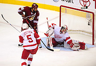 Apr 23, 2010; Glendale, AZ, USA; Detroit Red Wings goalie Jimmy Howard (35) makes a glove save during the third period of game five in the first round of the 2010 Stanley Cup Playoffs at Jobing.com Arena.  Mandatory Credit: Jennifer Stewart-US PRESSWIRE