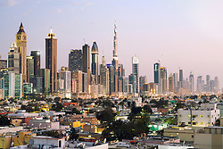 Evening view across old Al Satwa district towards modern skyline of Dubai with skyscrapers in United Arab Emirates