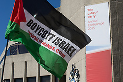 """© Licensed to London News Pictures . 27/09/2015 . Brighton , UK . Palestinian flag with the words """" Boycott Israel """" on it outside the 2015 Labour Party Conference . Photo credit : Joel Goodman/LNP"""