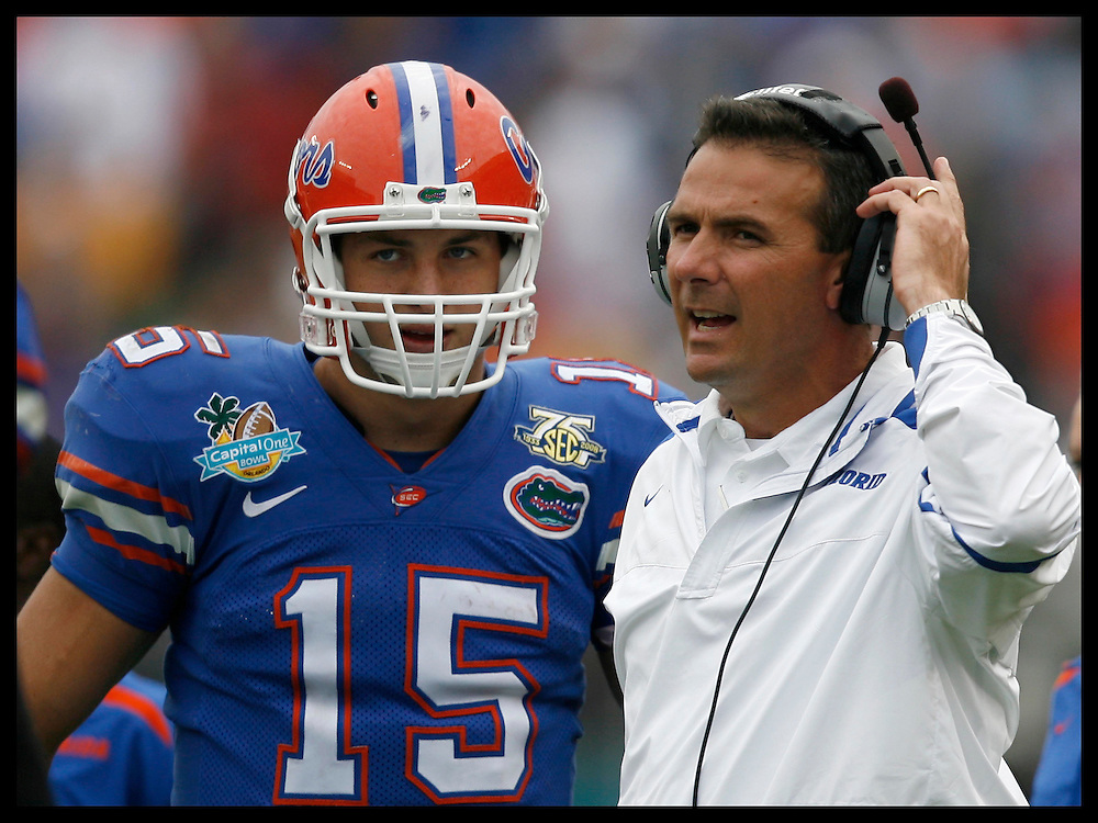 Head Coach Urban Meyer and QB Tim Tebow talk during a timeout  at the 2008 Capital One Bowl held at the Florida Citrus Bowl in Orlando, FL. Jan 1, 2008