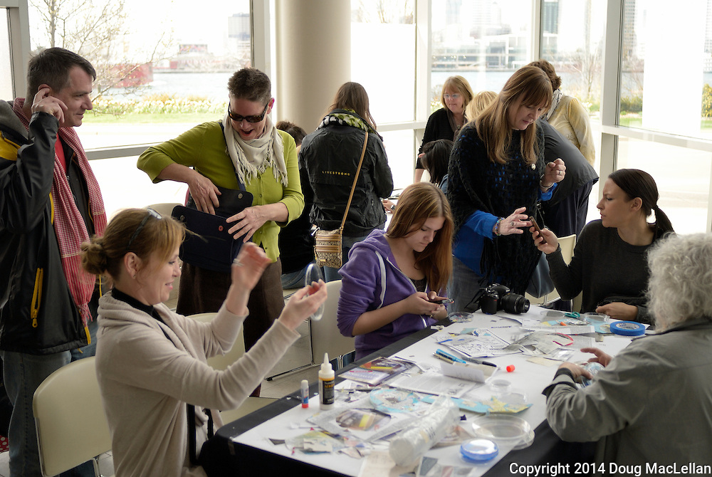 "A group of people work on various art creations or talk during the first ""We are Working on IT (WWOIT)"" at the Art Gallery of Ontario. WWOIT is part of MayWorks Windsor 2014, a labour oriented arts festival."