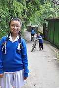 Young girl in uniform on the way to school Darjeeling, West Bengal, India