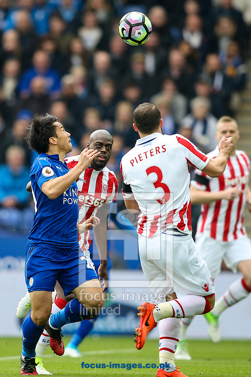 Shinji Okazaki of Leicester City (left) competing with Erik Pieters of Stoke City (right) during the Premier League match at the King Power Stadium, Leicester<br /> Picture by Andy Kearns/Focus Images Ltd 0781 864 4264<br /> 01/04/2017