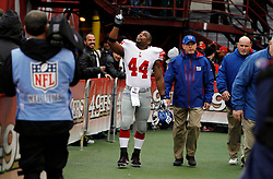 Jan 22, 2012; San Francisco, CA, USA; New York Giants head coach Tom Coughlin heads out to the field with running back Ahmad Bradshaw (44) before the 2011 NFC Championship game against the San Francisco 49ers at Candlestick Park.  Mandatory Credit: Jason O. Watson-US PRESSWIRE