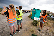 Teamleden maken foto's van de lucht. Door zware regenval gaan de races op dinsdagavond niet door. Het Human Power Team Delft en Amsterdam, dat bestaat uit studenten van de TU Delft en de VU Amsterdam, is in Amerika om tijdens de World Human Powered Speed Challenge in Nevada een poging te doen het wereldrecord snelfietsen voor vrouwen te verbreken met de VeloX 7, een gestroomlijnde ligfiets. Het record is met 121,44 km/h sinds 2009 in handen van de Francaise Barbara Buatois. De Canadees Todd Reichert is de snelste man met 144,17 km/h sinds 2016.<br /> <br /> With the VeloX 7, a special recumbent bike, the Human Power Team Delft and Amsterdam, consisting of students of the TU Delft and the VU Amsterdam, wants to set a new woman's world record cycling in September at the World Human Powered Speed Challenge in Nevada. The current speed record is 121,44 km/h, set in 2009 by Barbara Buatois. The fastest man is Todd Reichert with 144,17 km/h.