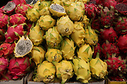 A market stall selling yellow and red pitaya