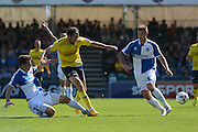 Tom Lockyer tackles Danny Hylton during the Sky Bet League 2 match between Bristol Rovers and Oxford United at the Memorial Stadium, Bristol, England on 6 September 2015. Photo by Alan Franklin.