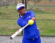 Hampton University Softball Head Coach Trena Peel warming up her players prior to Hampton's doubleheader split against Morgan State at the Lady Pirates Softball Complex on the campus of Hampton University in Hampton, Virginia.  (Photo by Mark W. Sutton)