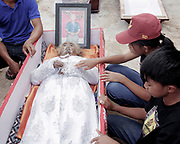 The body of Martha Limbong, who died in 2015 at age 72.<br /> <br /> Ma'nene is a tradition that takes place in August after harvest where the bodies of the dead loved ones are exhumed to be cleaned, groomed and dressed. For most, it's a bittersweet moment, a chance to reunite and physically see and touch and reconnect with loved ones who had passed on.