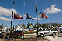 Blacksburg, Va. UNITED STATES: Flags fly at half mast as media trucks fill up the parking lot of the VA. Tech campus April 17, 2007  in Blacksburg, Virginia. A 23-year-old student from South Korea was identifiedas the gunman who carried out the deadliest school shooting in US history.  33 people died on Monday, police named the gunman as Cho Seung-Hui, a student at the school and resident alien in the United States. (AMi Vitale)