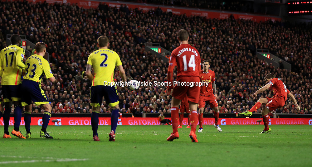 26th March 2014 - Barclays Premier League - Liverpool v Sunderland - Steven Gerrard of Liverpool scores their 1st goal with a free kick - Photo: Simon Stacpoole / Offside.