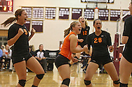 Solon's Emma Rickels (9), Rylee Smith (4), Jordan Smith (12), and Vik Meade (28) are pumped up after a score during the WaMaC Tournament semifinal game at Mount Vernon High School in Mount Vernon on Thursday October 11, 2012. Solon defeated Mount Vernon 26-24, 25-22.