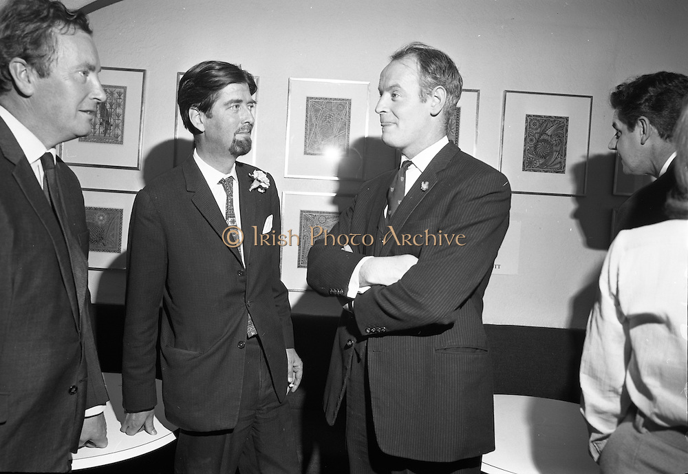 26/07/1967<br /> 07/26/1967<br /> 26 July 1967<br /> Opening of exhibition of paintings by Asgeir Scott at Brown Thomas, Grafton Street, Dublin. London born Scott, designer, illustrator, commercial artist and fashion artist came to Ireland in 1965. Here he devoted himself to a contemporary approach to the visual arts and produced a series of pictures. This collection was displayed in the Social and Personal Restaurant, Brown Thomas Ltd., Grafton Street and the opening was performed by Mr. Ulick O'Connor. Pictured at the opening were (l-r): Mr. John Ryan, Proprietor of the building; Mr. Asgeir Scott and Mr. Ulick O'Connor.