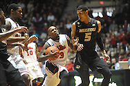 "Mississippi's Derrick Millinghaus (3) scores against Missouri's Jordan Clarkson (5) at the C.M. ""Tad"" Smith Coliseum in Oxford, Miss. on Saturday, February 8, 2014. Mississippi won 91-88."