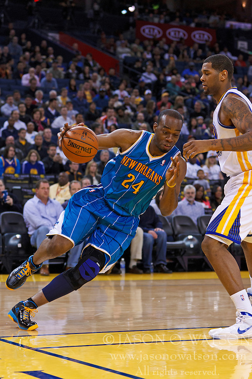 Mar 28, 2012; Oakland, CA, USA; New Orleans Hornets power forward Carl Landry (24) dribbles the ball against the Golden State Warriors during the first quarter at Oracle Arena. New Orleans defeated Golden State 102-87. Mandatory Credit: Jason O. Watson-US PRESSWIRE