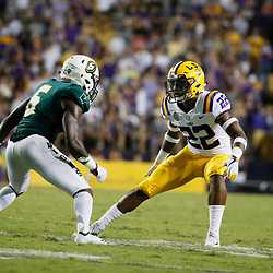 Sep 8, 2018; Baton Rouge, LA, USA; LSU Tigers cornerback Kristian Fulton (22) defends against Southeastern Louisiana Lions wide receiver Juwan Petit-Frere (5) during the second half of a game at Tiger Stadium. LSU defeated Southeastern 31-0. Mandatory Credit: Derick E. Hingle-USA TODAY Sports