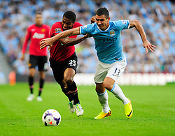 Manchester United's Luis Antonio Valencia jostles for the ball with Manchester City's Aleksandar Kolarov - Photo mandatory by-line: Dougie Allward/JMP - Tel: Mobile: 07966 386802 22/09/2013 - SPORT - FOOTBALL - City of Manchester Stadium - Manchester - Manchester City V Manchester United - Barclays Premier League
