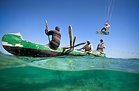 Kristin Boese kitesurfs over bewildered local fishermen near Anakao, Madagascar in this over/under shot I captured from the water.