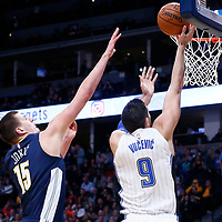 11 November 2017: Orlando Magic center Nikola Vucevic (9) goes for the layup past Denver Nuggets center Nikola Jokic (15) during the Denver Nuggets 125-107 victory over the Orlando Magic, at the Pepsi Center, Denver, Colorado, USA.