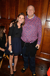 CLEMENCE KRZENTOWSKI and JEAN PIGOZZI at a party to celebrate opening of Galerie Kreo in London held at Il Bottaccio, Grosvenor Place, London on 17th September 2014.
