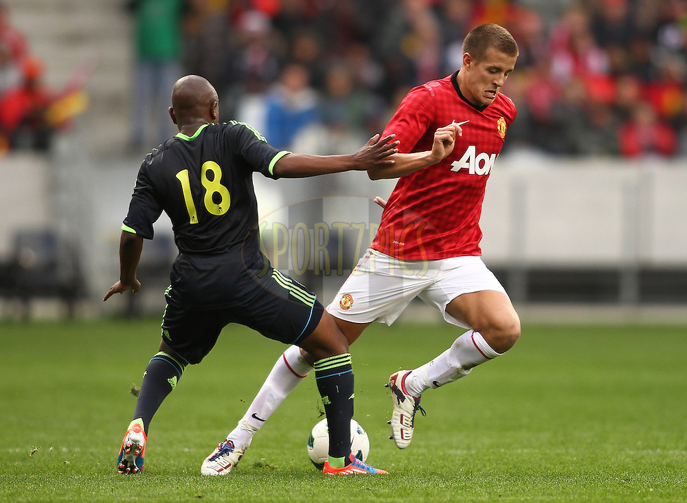 Paul Rusike of Ajax Cape Town tackles Scott Wootton of Manchester United during the Football Invitational 2012 match between Ajax Cape Town and Manchester United held at Cape Town Stadium on 21 July 2012 in Cape Town, South Africa..Photo by Shaun Roy / Sportzpics