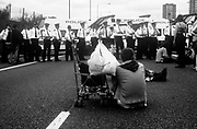 Protestors seated in front of police line, Reclaim the Streets London, Shepherd's Bush, July 1996