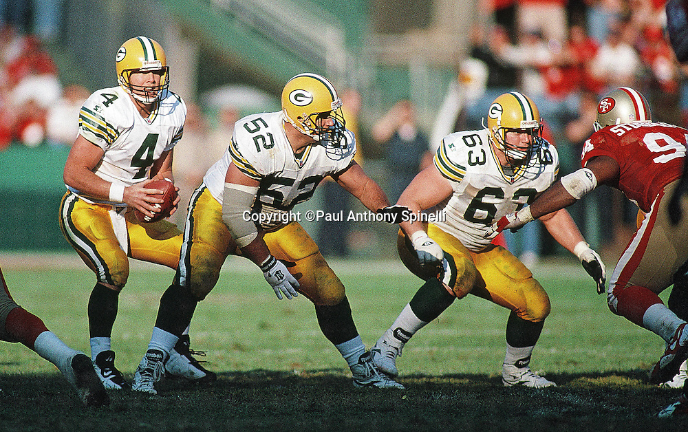 Green Bay Packers center Frank Winters (52) and Packers guard Adam Timmerman (63) block for Packers quarterback Brett Favre (4) during the NFL NFC Divisional Playoff football game against the San Francisco 49ers on Jan. 6, 1996 in San Francisco. The Packers won the game 27-17. (©Paul Anthony Spinelli)