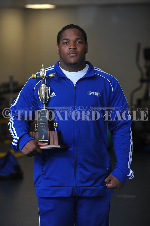 Oxford High weightlifter Challen Griffin holds the state championship trophy in Oxford, Miss. on Monday, April 15, 2013. Oxford High won the Class 5A state championship on Saturday at the Mississippi Coliseum in Jackson, Miss..