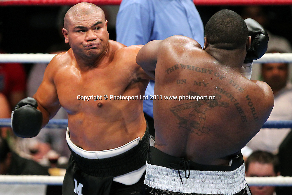David Tua throws a punch at King. David Tua v Demitrice King. Backyard Brawl. TelstraClear Pacific Events Centre, Auckland, New Zealand. Saturday 19th March 2011. Photo: Anthony Au-Yeung / photosport