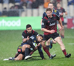 Highlanders Lima Sopoaga, centre, is tackled by Crusaders Richie Mo'unga, left, in the Super Rugby quarter final match, AMI Stadium, Christchurch, New Zealand, July 22 2017.  Credit:SNPA / Adam Binns ** NO ARCHIVING**