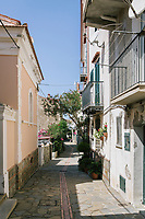 ACCIAROLI, ITALY - 14 SEPTEMBER 2018: A view of a street in Acciaroli, a small fishing village in the municipality of Pollica, Italy, on September 14th 2018.<br /> <br /> To understand how people can live longer throughout the world, researchers at University of California, San Diego School of Medicine have teamed up with colleagues at University of Rome La Sapienza to study a group of 300 citizens, all over 100 years old, living in Acciaroli (Pollica), a remote Italian village nestled between the ocean and mountains in Cilento, southern Italy.<br /> <br /> About 1-in-60 of the area's inhabitants are older than 90, according to the researchers. Such a concentration rivals that of other so-called blue zones, like Sardinia and Okinawa, which have unusually large percentages of very old people. In the 2010 census, about 1-in-163 Americans were 90 or older.