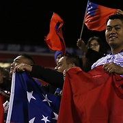 Proud Manu Samoa fans rejoice in Manu's current undefeated status at the first day of action at the USA Sevens, Sam Boyd Stadium, Las Vegas, Nevada.  Photo by Barry Markowitz, Courtesy STP/TriMarine, 1/24/14, 4pm