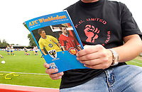 Picture by Daniel Hambury.<br /> 23/07/05.<br /> AFC wimbledon v Football Club United of Manchester. Pre season friendly.<br /> A fan wears a t shirt of FC United.