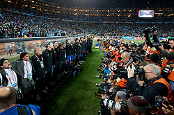 Coach of Argentina Diego Maradona and photographers during the national anthem of Argentina at the 2010 FIFA World Cup South Africa Round of Sixteen match between Argentina and Mexico at Soccer City Stadium on June 27, 2010 in Johannesburg, South Africa. (Photo by Vid Ponikvar / Sportida)