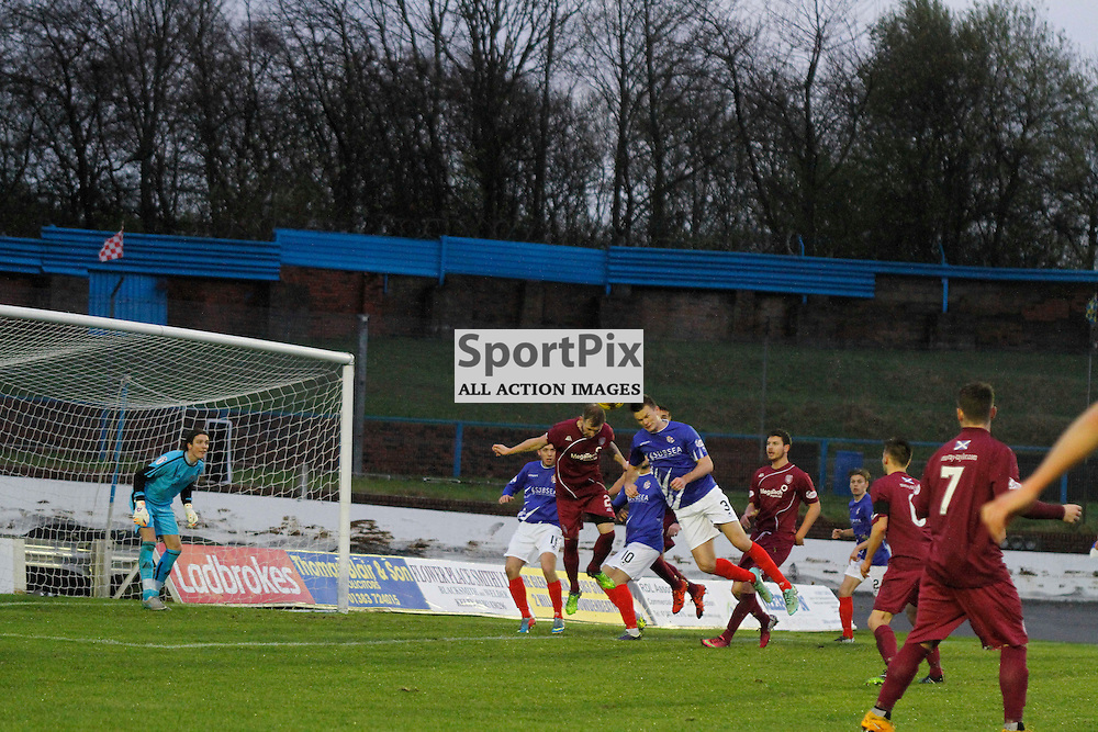 Cowdenbeath FC V Arbroath FC, Scottish Cup Round 3, 28 November 2015Cowdenbeath FC V Arbroath FC, Scottish Cup Round 3, 28 November 2015<br /> <br /> COWDENBEATH #3 FRASER KERR IN HIS FIRST HOME GAME FOR THE CLUB GETS HIS HEAD TO THE BALL WITH ARBROATH #2 CRAIG WILSON
