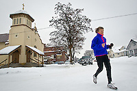 Sister Madonna Buder jogs away from St. Anthony's Church following mass Wednesday morning in Spokane.