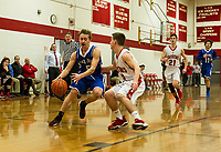 Inter Lakes' Thomas DeTolla dribbles down court with pressure from Ryan Dee during NHIAA Division III basketball on Tuesday evening.  (Karen Bobotas/for the Laconia Daily Sun)