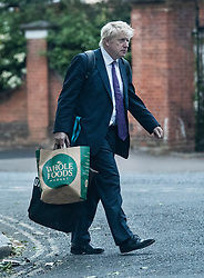 © Licensed to London News Pictures. 27/05/2019. London, UK. Conservative Party leadership candidate Boris Johnson is seen in south London with a Whole Foods Market carrier bag. Mr Johnson's partner Carrie Symonds is reported to be influencing his current diet and healthy living regime. Photo credit: Peter Macdiarmid/LNP