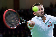 Michal Przysiezny of Poland competes at first single match during the BNP Paribas Davis Cup 2014 between Poland and Croatia at Torwar Hall in Warsaw on April 4, 2014.<br /> <br /> Poland, Warsaw, April 4, 2014<br /> <br /> Picture also available in RAW (NEF) or TIFF format on special request.<br /> <br /> For editorial use only. Any commercial or promotional use requires permission.<br /> <br /> Mandatory credit:<br /> Photo by © Adam Nurkiewicz / Mediasport
