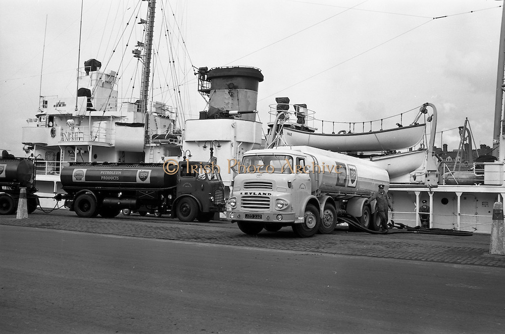 21/03/1963<br /> 03/21/1963<br /> 21 March 1963<br /> Shell tankers,(Leyland Octopus and a Leyland Beaver) loading 17,000 gallons of fuel on U.S. Coastguard ship the USCGC Half Moon at Sir John Rogerson's Quay, Dublin. Special for Shell B.P.