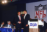 (L-R) NFL Commissioner Pete Rozelle poses for a photo with Tampa Bay Buccaneers quarterback Vinny Testaverde after Testaverde is selected as the number one overall draft pick during the 1987 NFL Draft on April 28, 1987 in New York. (©Paul Anthony Spinelli)