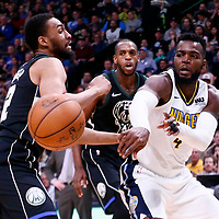 01 April 2018: Denver Nuggets forward Paul Millsap (4) passes the ball past Milwaukee Bucks forward Jabari Parker (12) during the Denver Nuggets 128-125 victory over the Milwaukee Bucks, at the Pepsi Center, Denver, Colorado, USA.
