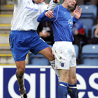Queen of the South v St Johnstone...22.10.05<br />Paul Sheerin challenges Eric Paton<br /><br />Picture by Graeme Hart.<br />Copyright Perthshire Picture Agency<br />Tel: 01738 623350  Mobile: 07990 594431