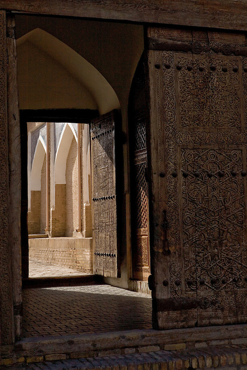 Through the wooden doors of Ark fortress in Khiva