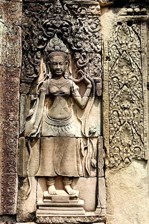 Angkor Thom: Bayon, sculptures of apsara dancers in high relief, with panels of carved foliage
