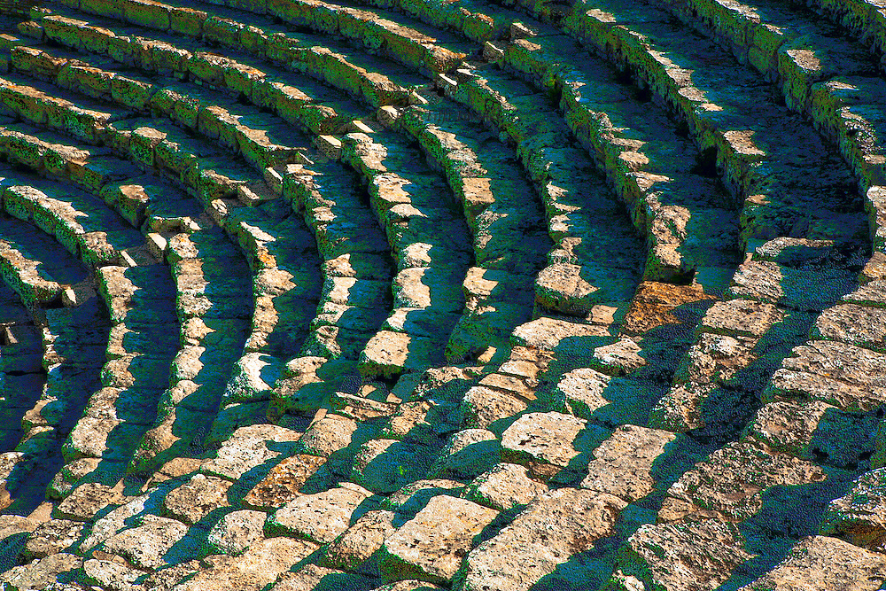 Sicily : Theater at Segesta, 3d century BC. Shadow patterns on the seats and stairs.