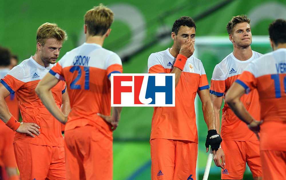 Netherlands' players react after missing the men's semifinal field hockey Belgium vs Netherlands match of the Rio 2016 Olympics Games at the Olympic Hockey Centre in Rio de Janeiro on August 16, 2016.  / AFP / Carl DE SOUZA        (Photo credit should read CARL DE SOUZA/AFP/Getty Images)