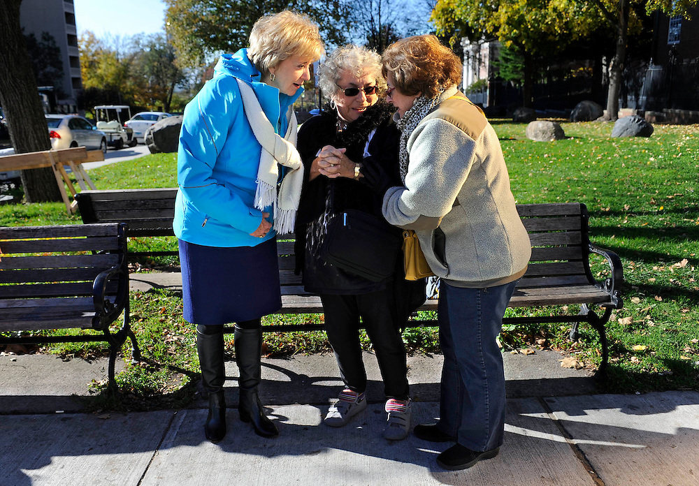 Republican candidate for U.S. Senate Linda McMahon, left, talks with Marilyn D'Auria of Vernon and Maryanne Buccini of Tolland during the Connecticut Veterans Day parade in Hartford, Conn. McMahon and Democratic opponent Chris Murphy are vying for the Senate seat now held by Joe Lieberman, an independent who's retiring. (AP Photo/Jessica Hill)